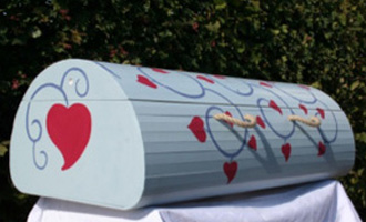 The new wood Curve coffin, painted to order
