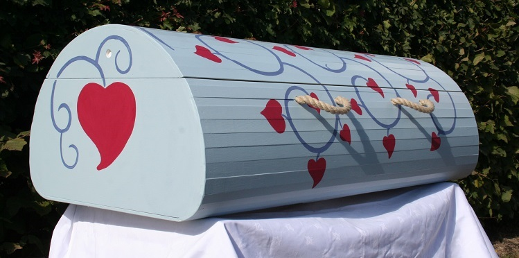 funerals-totnes-devon-wood-coffins-curve-decorated